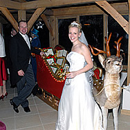 Giles and Amelia with Christmas Reindeer, Wedding at Gaynes Park, Epping, Kent