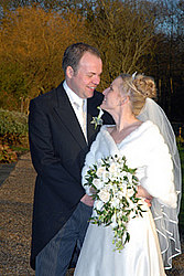 Giles and Amelia celebrating their Christmas Wedding at Gaynes Park, Epping, Kent