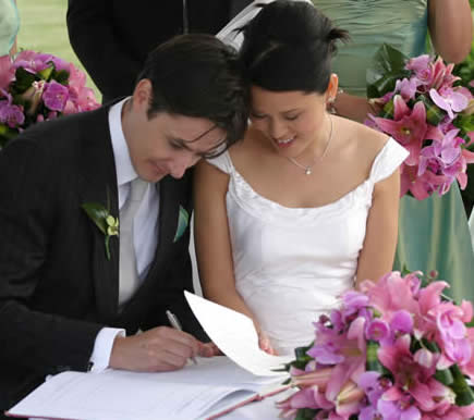 Bride and groom signing register, Kent Wedding Professionals for quality services