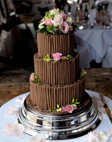 Chocolate Wedding Cake decorated with fresh floral decoration by Kent Florist