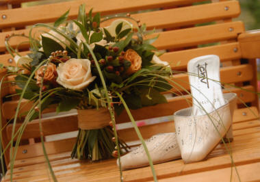 Wedding Bouquet created by Kent Florist displayed with Bridal Shoes